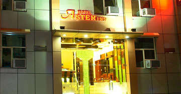 Exterior view of Aster Inn Hotel in Karol Bagh