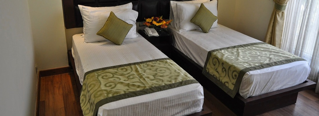 Deluxe Rooms at  Hotel Mapple Express New Delhi